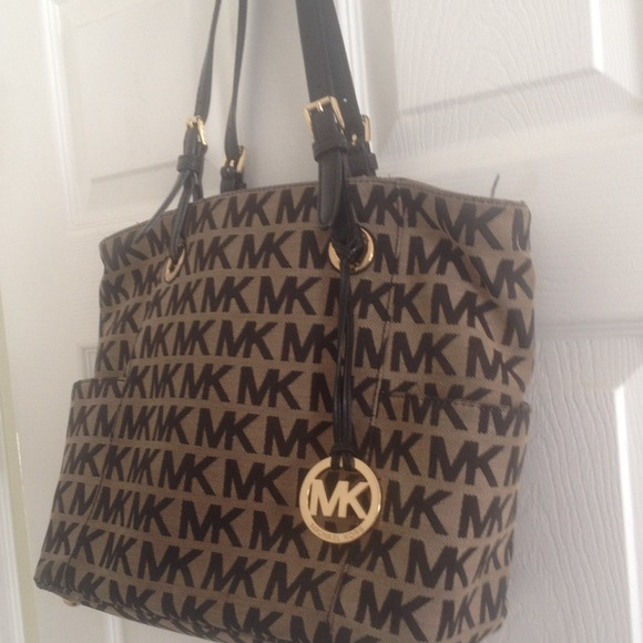 bcd900681428 Buy michael kors black and brown purse > OFF65% Discounted