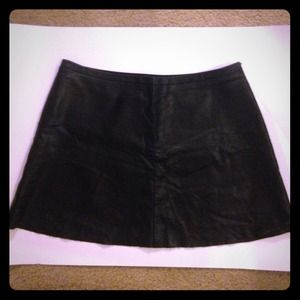 BCBG black leather mini skirt. Size l.