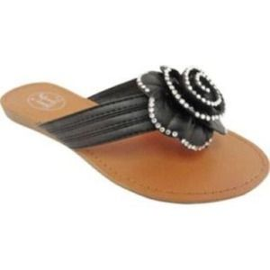 Carrini woman's Studded flower sandals. LOOK