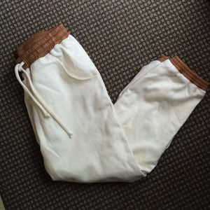 Cream wool sweatpants w/tan leather bands