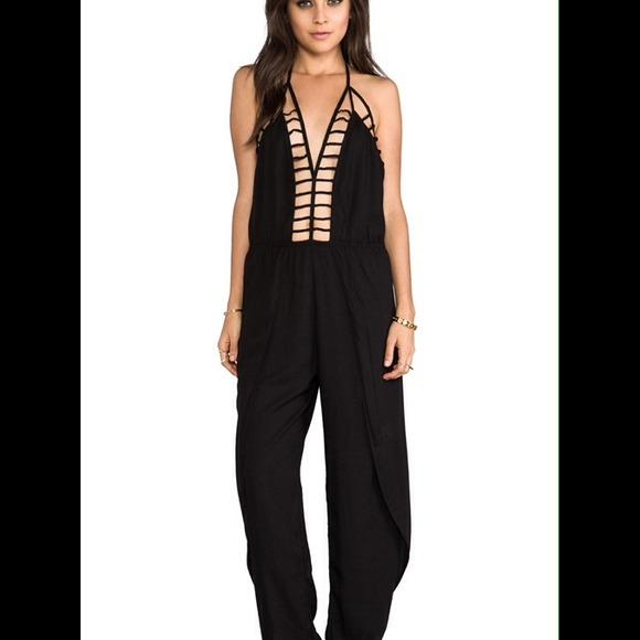 d59438f25b9 Indah Clothing  Gypsy deep V cutout trim jumpsuit