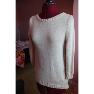 Beige fitted high low sweater. It's very fitted