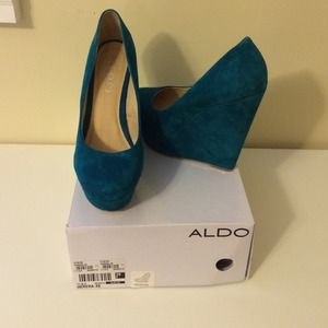 Brand new suede Aldo 5.5 in. wedges.