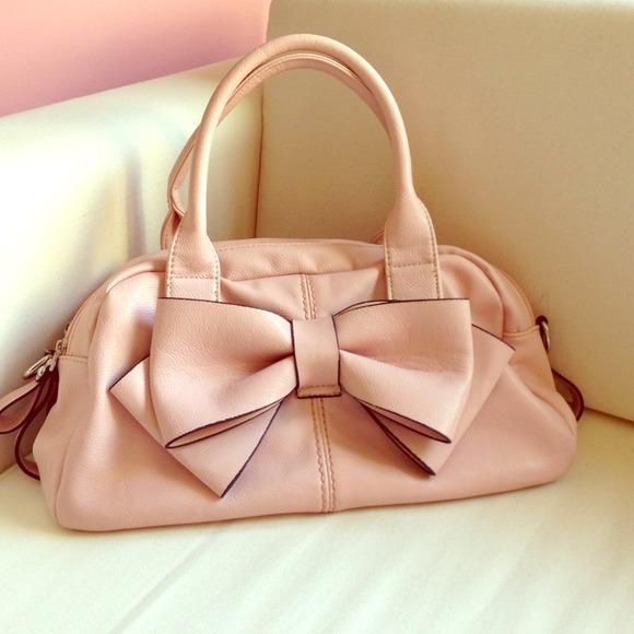 61% off Charming Charlie Handbags - Pink Bow Handbag from ...