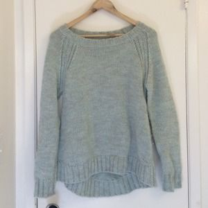 Knit mint and grayish sweater.