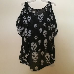 Black and white skull blouse.