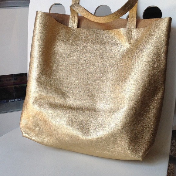 80% off RoviMoss Handbags - {HP} Real leather gold silver shopper ...