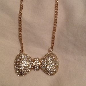 Bow necklace with gold rhinestones