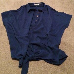Blue half buttoned up shirt