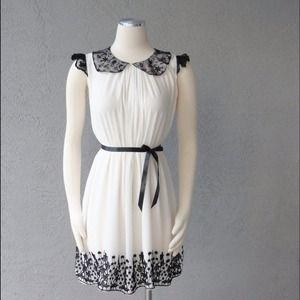 Dresses & Skirts - Ivory chiffon dress with black Venice lace trim.