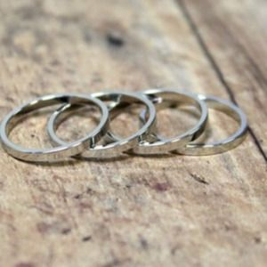 4 silver midi rings above the knuckle rings