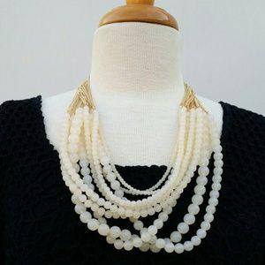 Multi strand cream/gold beaded necklace