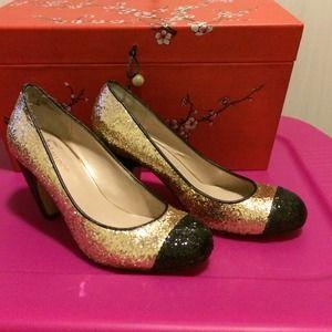 Gold & black shoes