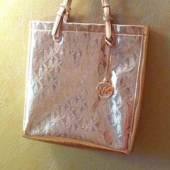 1135c39d3c32 Michael Kors Metallic Rose Gold Handbag. M_54061f350b47d309bd34d49f