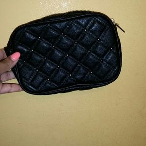 Black quilted small hand bag.