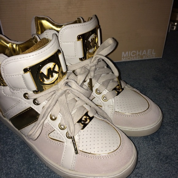 68f459f34ebfd Michael Kors White and Gold High Tops size 6