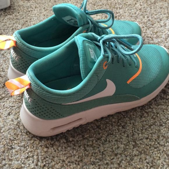98e825ddd96c ... Nike Air Max Thea Teal Neon Orange Combo. M 540dd77edd7b7f7708227ea3