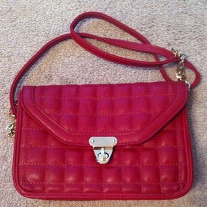 Burgundy quilted cross body bag.