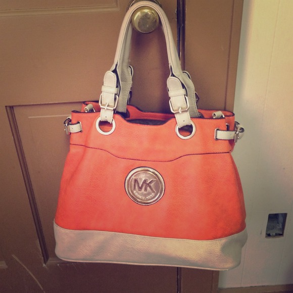 Original Michael Kors Orange   tan purse. M 54106624e6ce28467d39202a b13259d299909