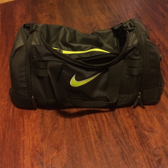 Black with lime green nike duffle bag. M 54120c3394c7de5ab2091620 41b224b7695d9