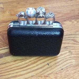 Black skull handle clutch