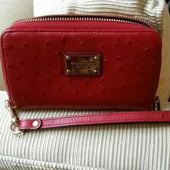 e58da0042c840e Michael Kors wristlet wallet Red ostrich essential.  M_541626693ddfd4055d26cd67
