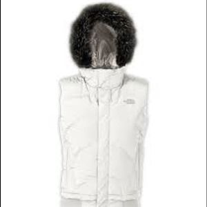 North Face hooded down vest with faux fur trim