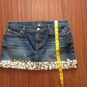 Denim skirt with shell embellishments