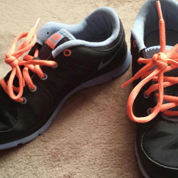Nikes colored light blue, black, and laces orange