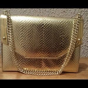 Gold mini flap bag