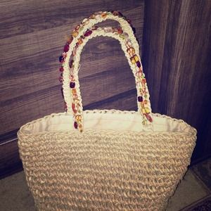 Straw tote with beaded handles perfect for beach
