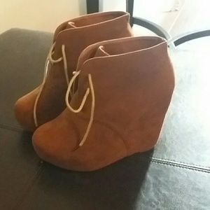 Brown wedge booties