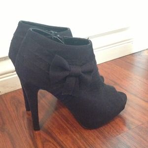 Peep toe heeled booties