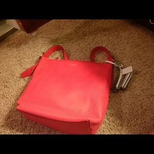 COACH LEGACY Leather large duffle perforated coral