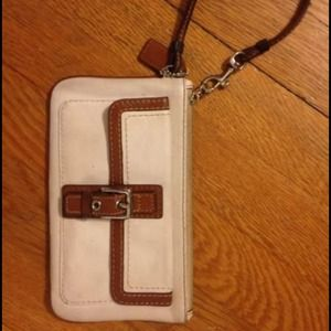 White and brown leather coach clutch