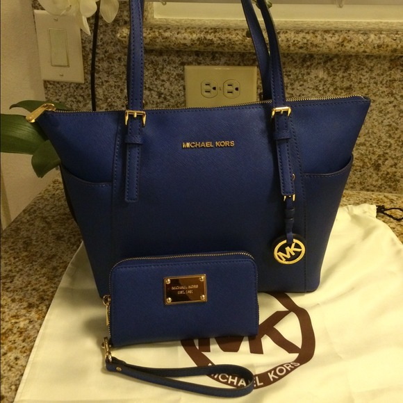 6ab6f7aa6a Authentic Michael Kors tote bag   matching wallet.  M 5438006d94c7de57de06c107