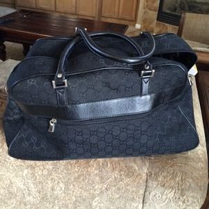 Gucci Handbags - 💯Authentic black Gucci  denim carry on.