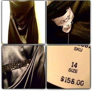Strapless cache dress with gun metal studs.