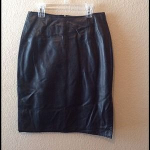 Black pencil leather, lined skirt.