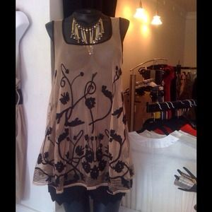 Nude mesh tunic with black appliqué