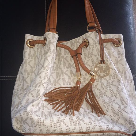 a4649d2571bd6e Michael Kors Vanilla Signature Drawstring Handbag.  M_544d551a0f6eb20540029563