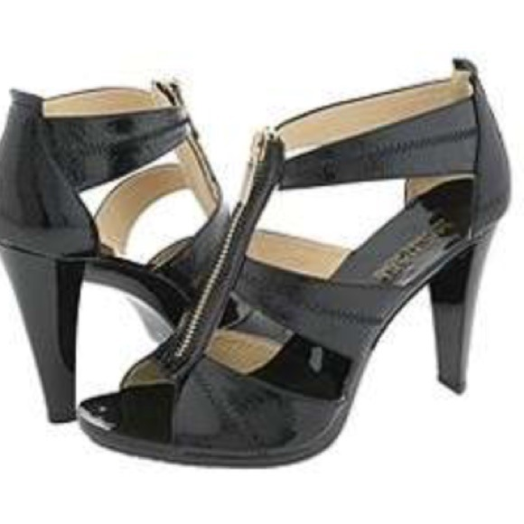 8a37e42559924 Michael kors black heels with gold zipper front. M 545b8d5a9da25942770e148f