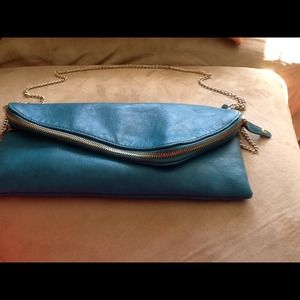 Turquoise clutch bag with gold chain strap