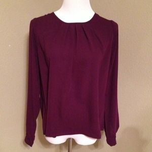 Woven long sleeve top. Eggplant in color.