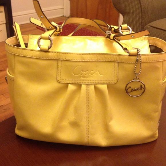 e2662dd572 Coach Handbags - Patent leather yellow Coach purse.