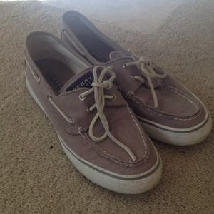 Gray sperry top sider shoes.