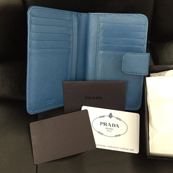 18% off Prada Clutches \u0026amp; Wallets - Prada Saffiano Triangle Bi-Fold ...