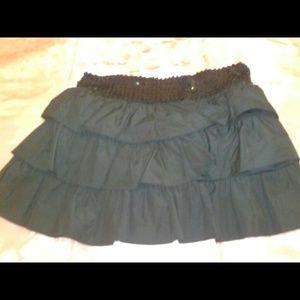Sequence waist band,  black skirt.