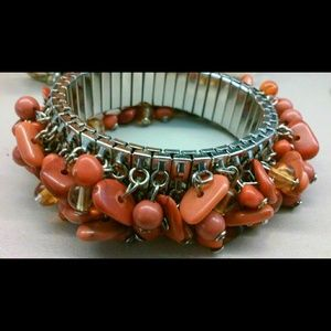 Jewelry - Orange dangle stretch bracelet *fits large wrist