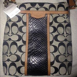 Black coach messenger bag